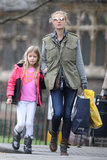 While strolling London with her daughter Apple, Gwyneth Paltrow topped her plaid blouse and gray cardigan with an olive green anorak vest for extra protection and pizazz.