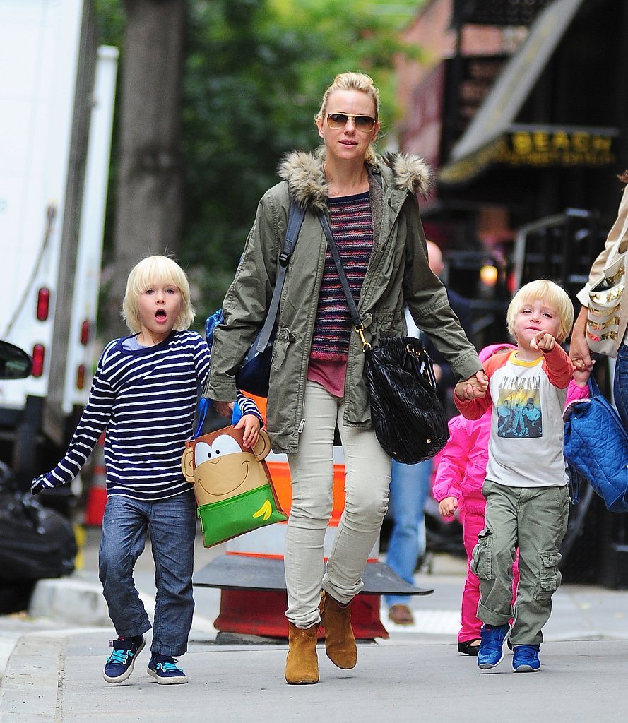 Naomi Watts sported a striped sweater, off-white corduroys, complete with a green fur-collar coat during a fashionable walk with her boys in NYC.