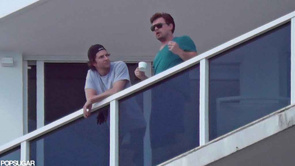 Leonardo DiCaprio sipped on coffee while chatting with Bradley Cooper.  Source: Coleman-Raynor