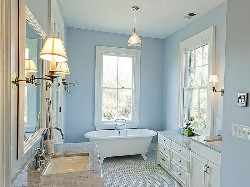 At the end of her first day visiting Noah, the two climb into an old-school claw-foot tub. In this bathroom, marble countertops and a simple pendant lamp make for a cool, modern contrast to the tub. Source: Sotheby's