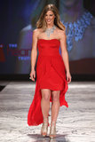 Torah Bright wore a strapless red gown by Nicole Miller.
