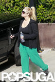 Jessica Simpson wore green sweatpants and a black tank top.