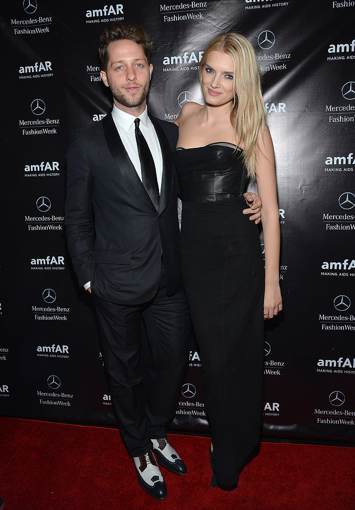 Lily Donaldson posed with Derek Blasberg at the amfAR party wearing a strapless gown with leather detailing.