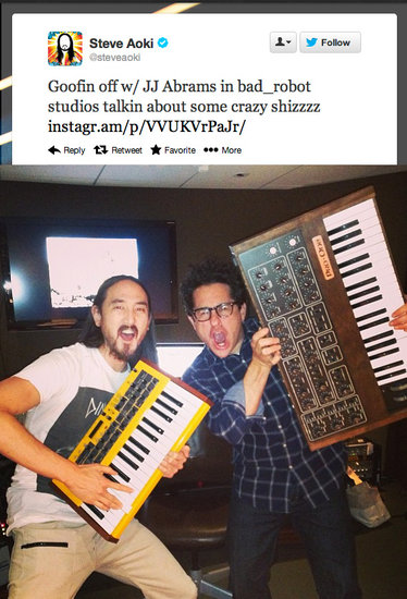 What could DJ Steve Aoki and future Star Wars director J.J. Abrams possibly be discussing? The soundtrack to a certain upcoming sci-fi feature film perhaps?