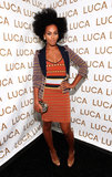 Solange debuted the perfect transitional colour palette in an orange, navy, and yellow ensemble at the Luca Luca Spring 2011 show in NYC. The fashion maven topped her knit aztec-print dress with a geometric blazer, then slipped on a pair of T-strap leopard sandals.