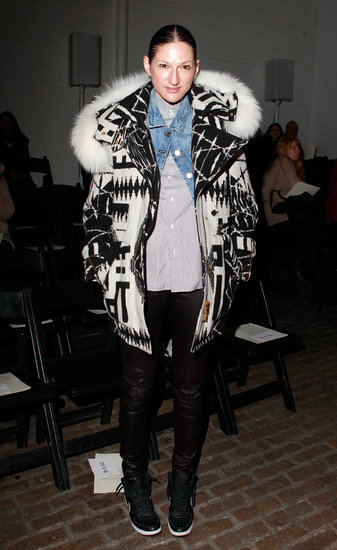 J.Crew's Jenna Lyons attended Yigal Azrouël's show looking extremely cozy in a black and white coat with a furry hood, which she layered over a denim jacket, a striped blouse, leather pants, and high-top sneakers.