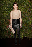 Emma wore a sleek leather Salvatore Ferragamo ensemble for the brand's Spring collection event in January 2013.