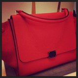 How stunning is the shade of orange on this Céline trapeze bag?