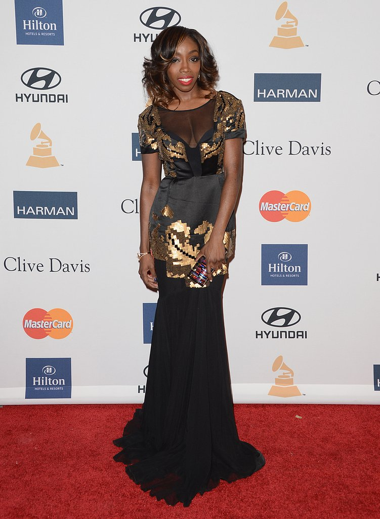 Estelle looked ravishing in black-silk gown with gold embellishments and a mermaid train.