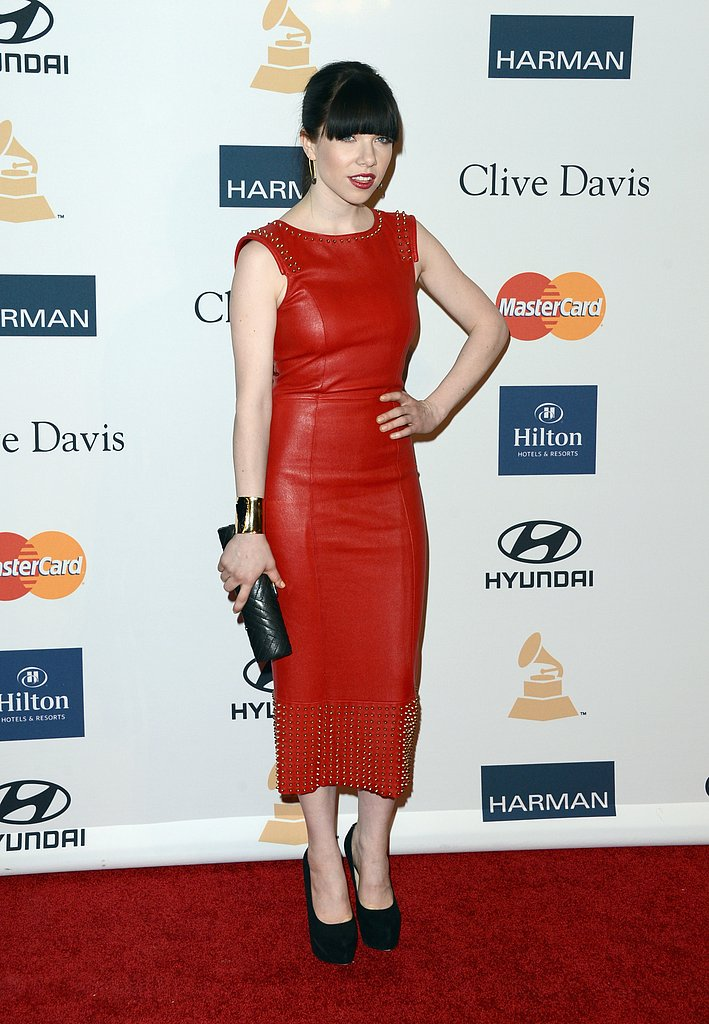 Carly Rae Jepsen went edgy in a studded red-leather sheath and black platform pumps. She accessorised with a quilted leather clutch, wide gold cuff, and quirky safety-pin earrings.