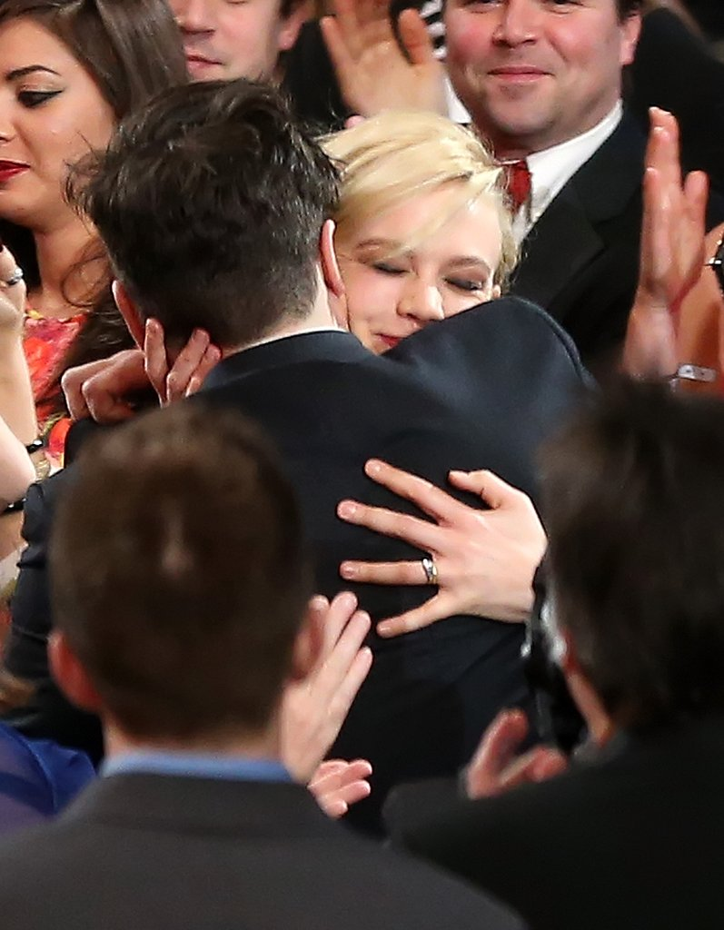 Carey Mulligan hugged her husband, Marcus Mumford, after his big win with Mumford & Sons.