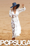 Miranda Kerr covered up a white bikini with a lacy dress.