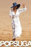 Miranda Kerr covered up a white bikini with a lacy dress.