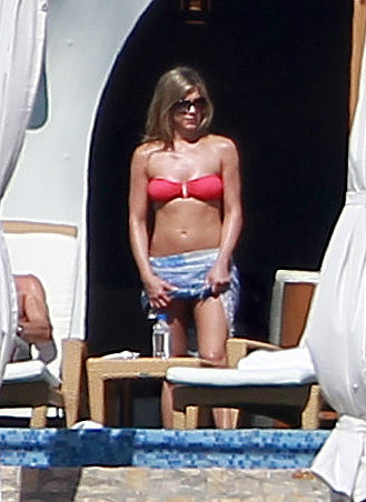 Jennifer Aniston wore a red bandeau bikini while spending Christmas in Cabo in December 2012.