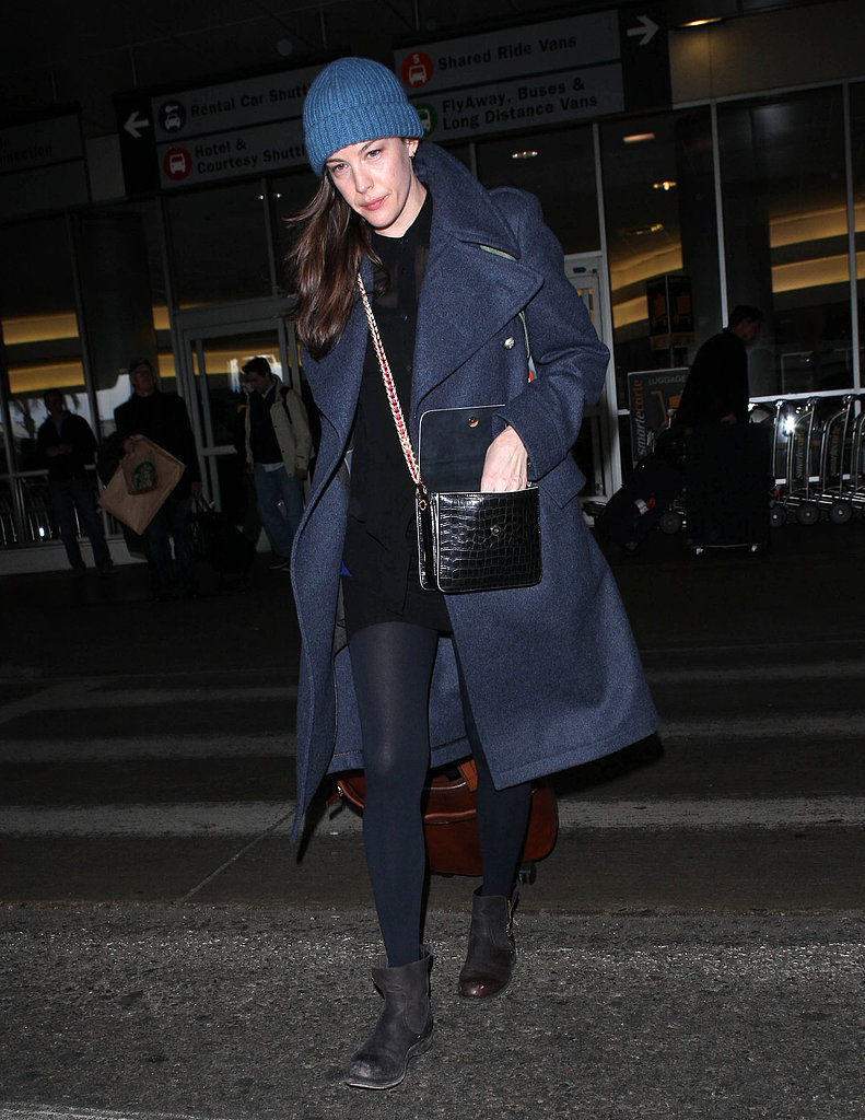 Liv Tyler bundled up in a navy coat and blue ribbed beanie while catching a flight out of LA.
