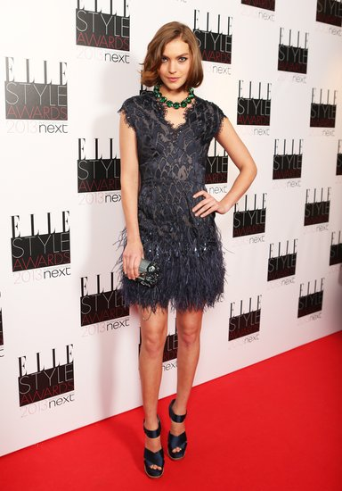 Model Arizona Muse also picked a feathery confection at the Elle Style Awards. We love the contrasting emerald  green necklace.