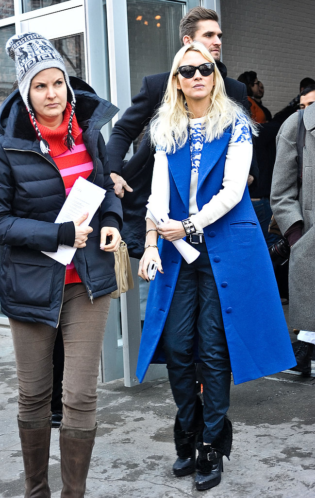 A bold blue sleeveless coat supplied a modern spin on polished daywear.