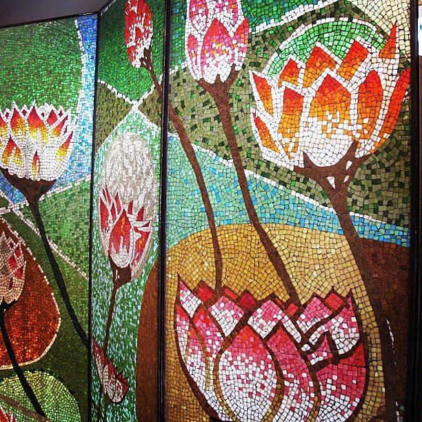 A vintage mosaic lotus-flower screen. Amazing.