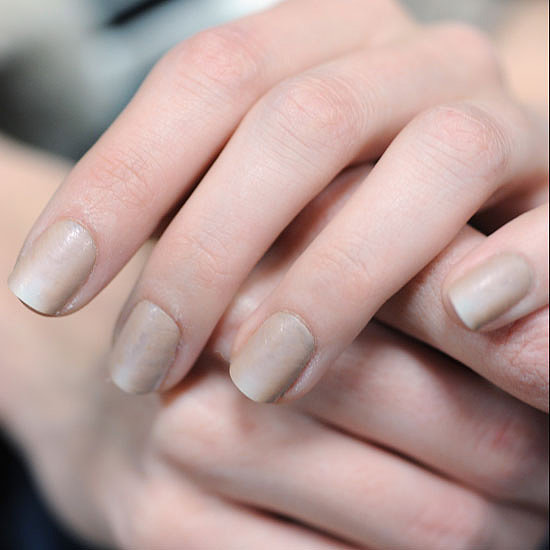 Wang took his androgynous favouritism to another level, asking CND lead artist Jan Arnold to create a unisex nail. The sandstone-inspired art was created by criss-crossing a fan brush up the nail before slapping down a speedy top coat. Artists then buffed away the shine of the top coat to add to the weathered, stone-like look.