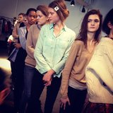 Models lined up backstage at Karen Walker.