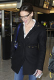 Jennifer Garner smiled as she traveled out of the London airport.