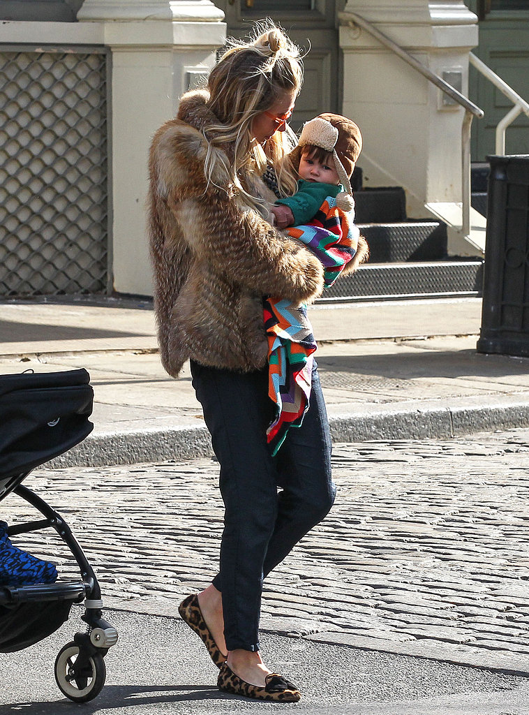 Sienna Miller wore a fur coat to carry daughter Marlowe Sturridge.