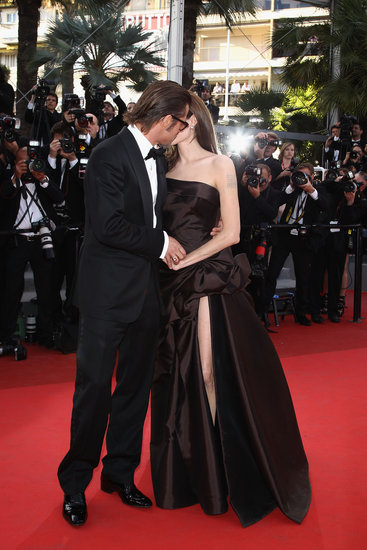 Brad Pitt planted a kiss on Angelina Jolie at the Cannes Film Festival in May 2011.