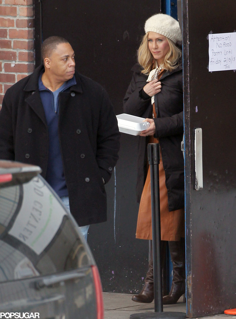 Jennifer Aniston covered her blond wig with a white cap on set in Stamford, CT.