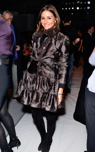 Olivia Palermo fought the NYC elements in a ruffled fur coat and suede boots at Dennis Basso.