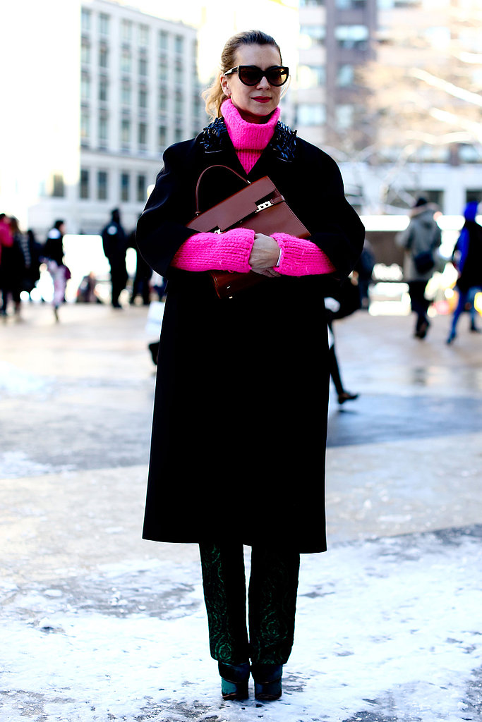 Natalie Joos turned up her palette with a saturated hot-pink knit underneath a classic coat.