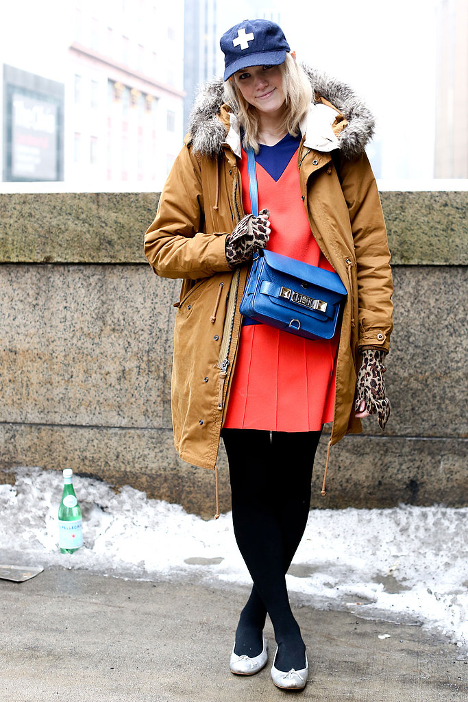 Fight serious cold with your warmest jacket. Make it feel stylish, rather than outdoors ready, with something bright underneath and chic accessories.