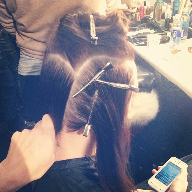 Clips, clips, and more clips during the final stages of hair prep at Nanette Lepore.