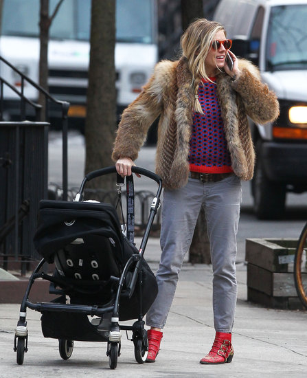 Sienna Miller wore a pair of red sunglasses.