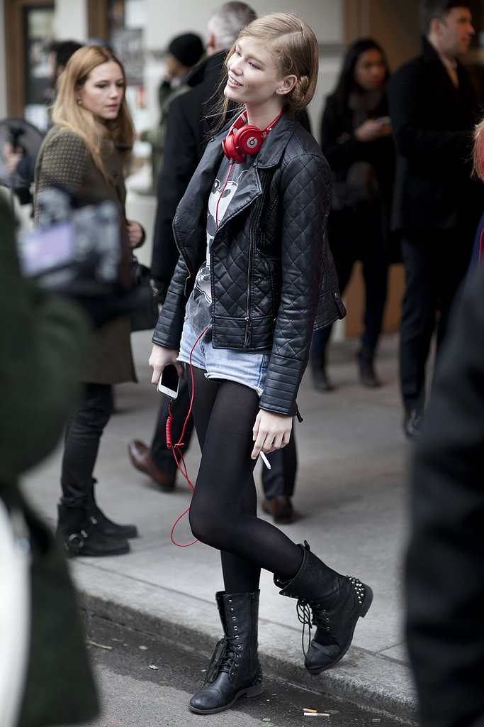 The quintessential off-duty model style: moto jacket, combat boots, cutoffs, and headphones.