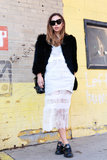 Rumi Neely gave her feminine wisp of a dress a Winter touch with a jet-black fur jacket.