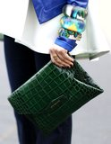 Givenchy's sharp envelope clutch got doused in a rich green hue.