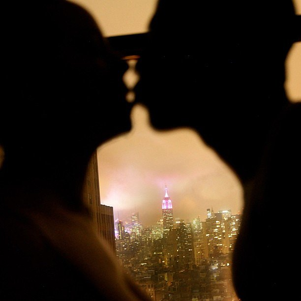 Mariah Carey shared a PDA pic with Nick Cannon showing the Empire State Building lit up in pink for Valentine's Day. Source: Instagram user mariahcarey