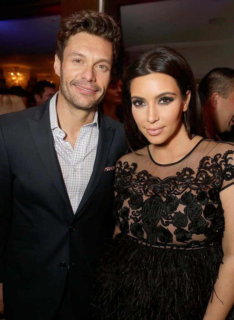 Kim Kardashian posed for photos with Ryan Seacrest.