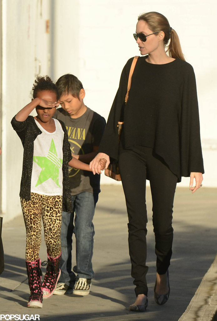 Angelina Jolie wore sunglasses to take her kids Zahara and Pax shopping in LA.
