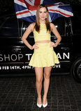 Christa B. Allen showed off her midriff in a bright yellow crop top and flared miniskirt. Her white pumps contrasted the color on top with something a bit more classic on bottom. Gaydamak earrings and a bracelet completed her party style.
