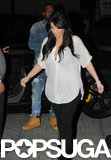 Kim Kardashian covered her baby bump with a sheer white blouse for a Valentine's date with boyfriend Kanye West.