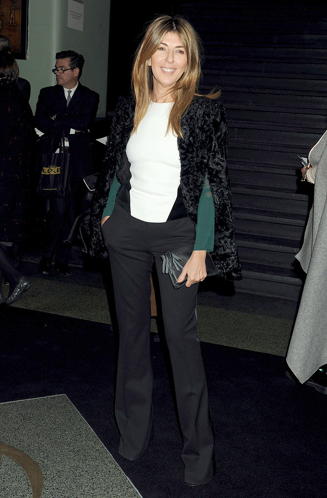Nina Garcia wore black pants and a white top.