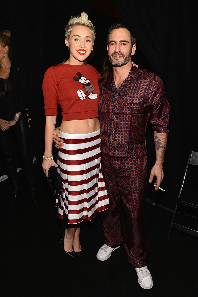 Miley Cyrus posed with Marc Jacobs backstage at his show.