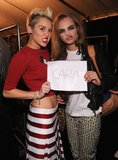 Miley Cyrus goofed off with Cara Delavigne backstage.