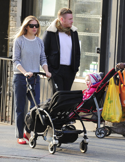 Sienna Miller pushed baby Marlowe in her stroller on a walk around NYC.