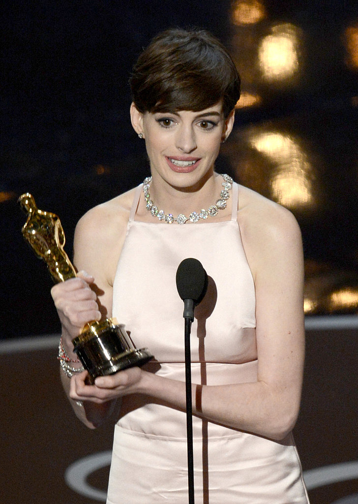 Anne Hathaway accepted her award at the 2013 Oscars.