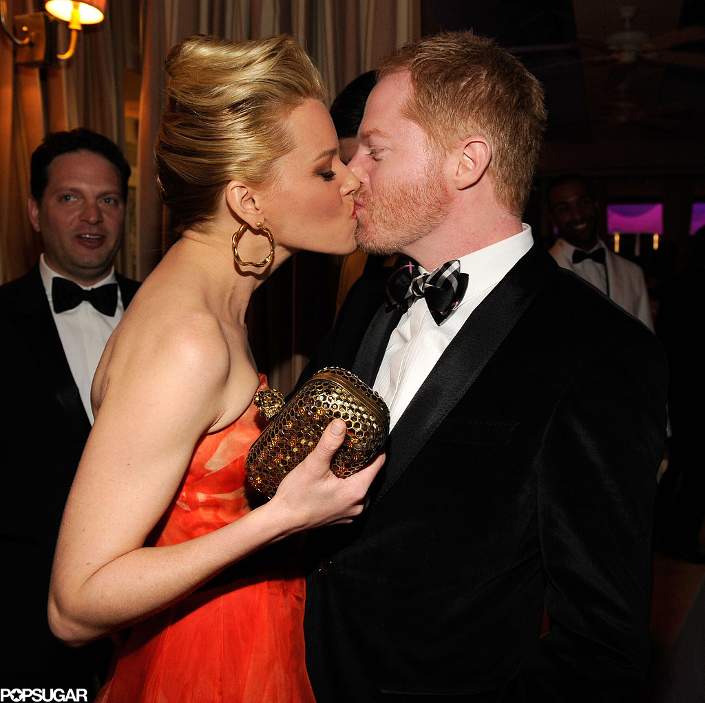 Elizabeth Banks and Jesse Tyler Ferguson locked lips inside the Vanity Fair Oscar party in Hollywood.