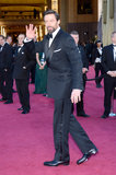 Hugh Jackman gave a wave as he made his way into the Oscars.