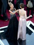 Anne Hathaway cracked Kristin Chenoweth up on the carpet.