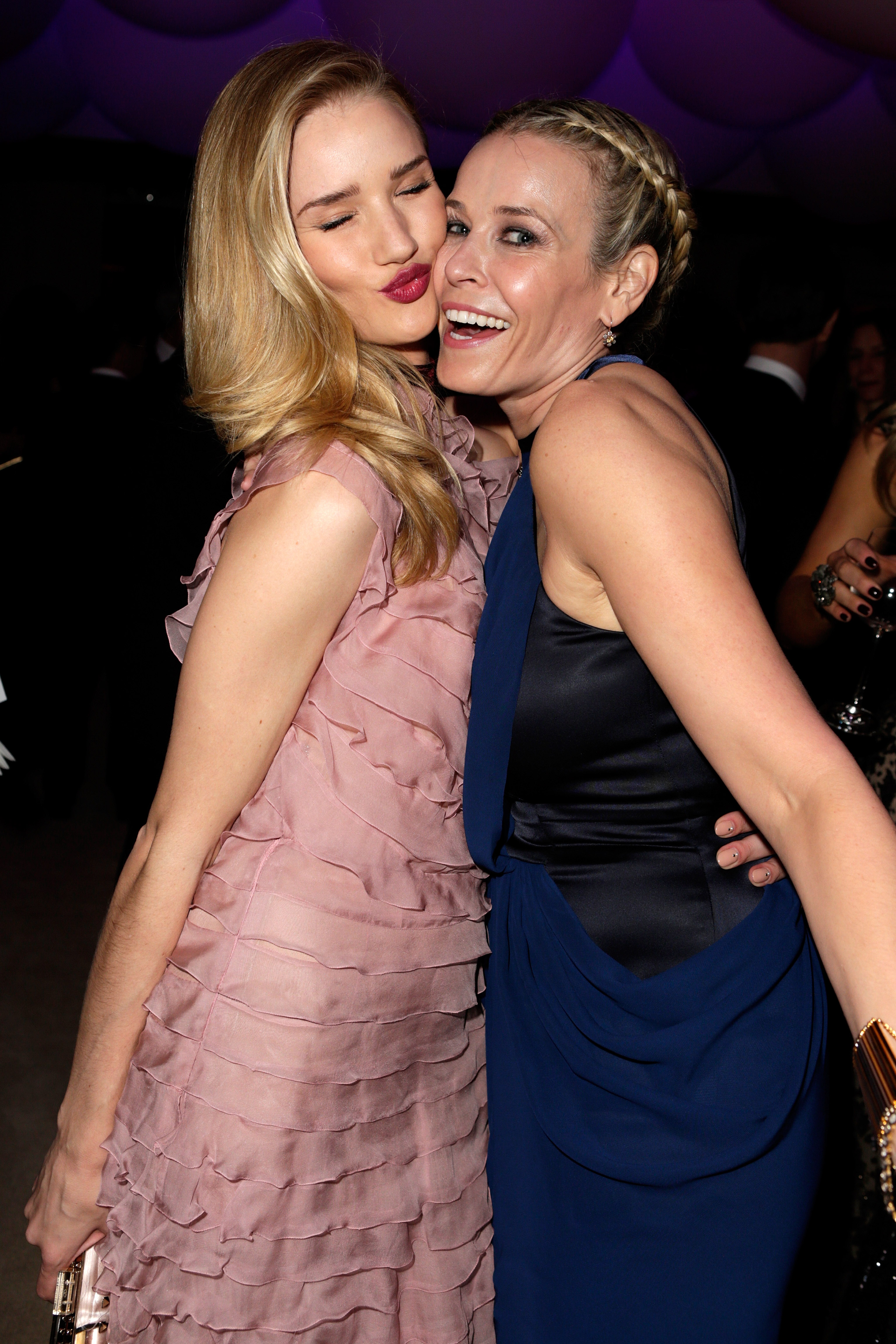 Rosie Huntington-Whiteley planted a kiss on Chelsea Handler at the Vanity Fair Oscar party on Sunday night.